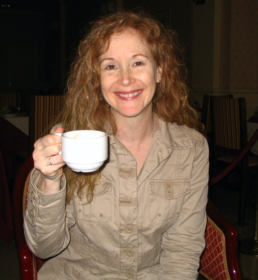 Redhead woman having coffee in Italy