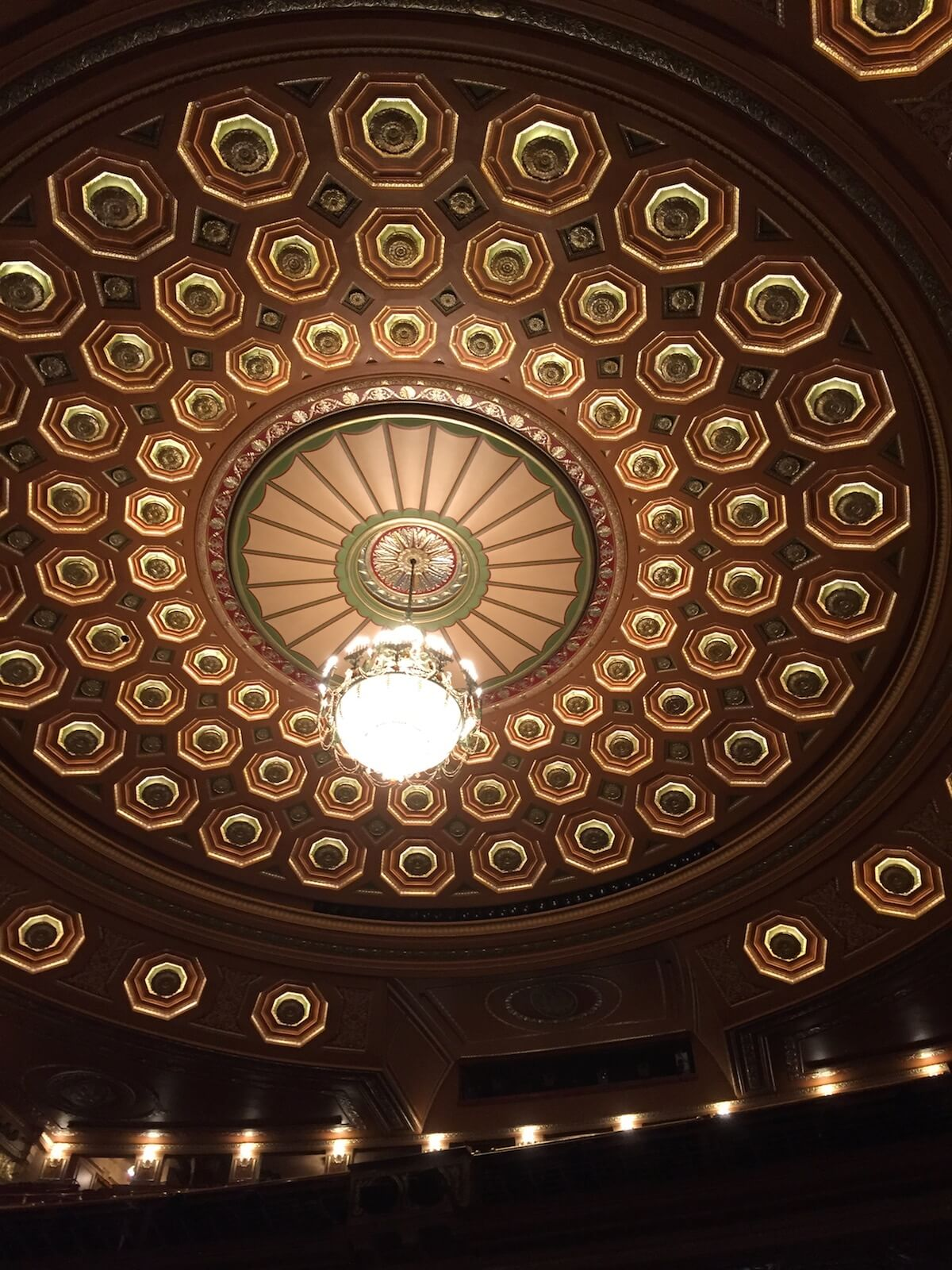 Round art deco ceiling in green and browns
