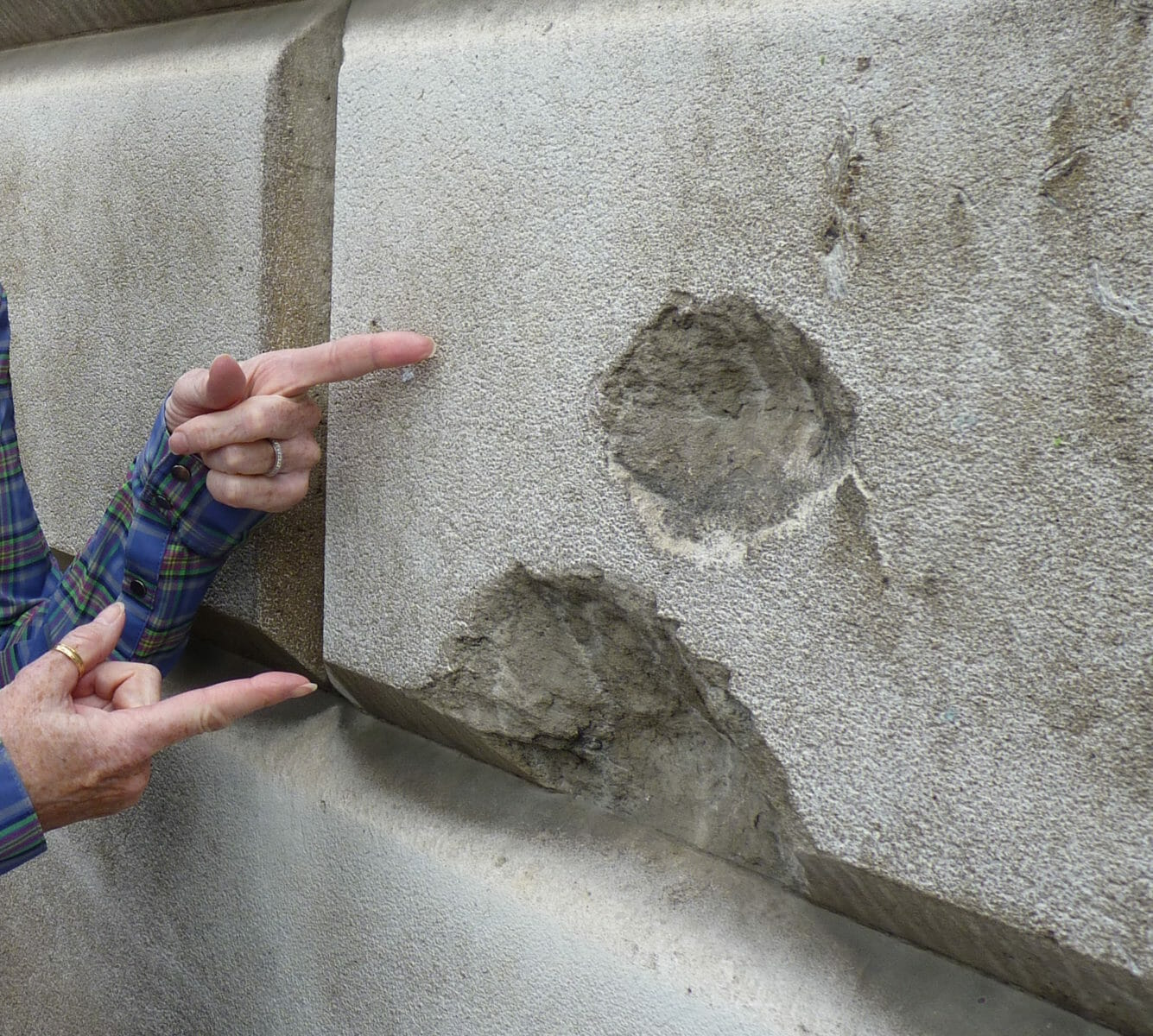 Bomb blasts from WWII on a London Wall