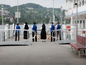 Horn blowers sending off a boat