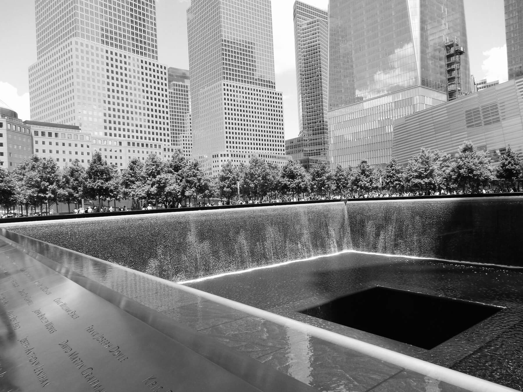 Black and white 9/11 Memorial, etched names