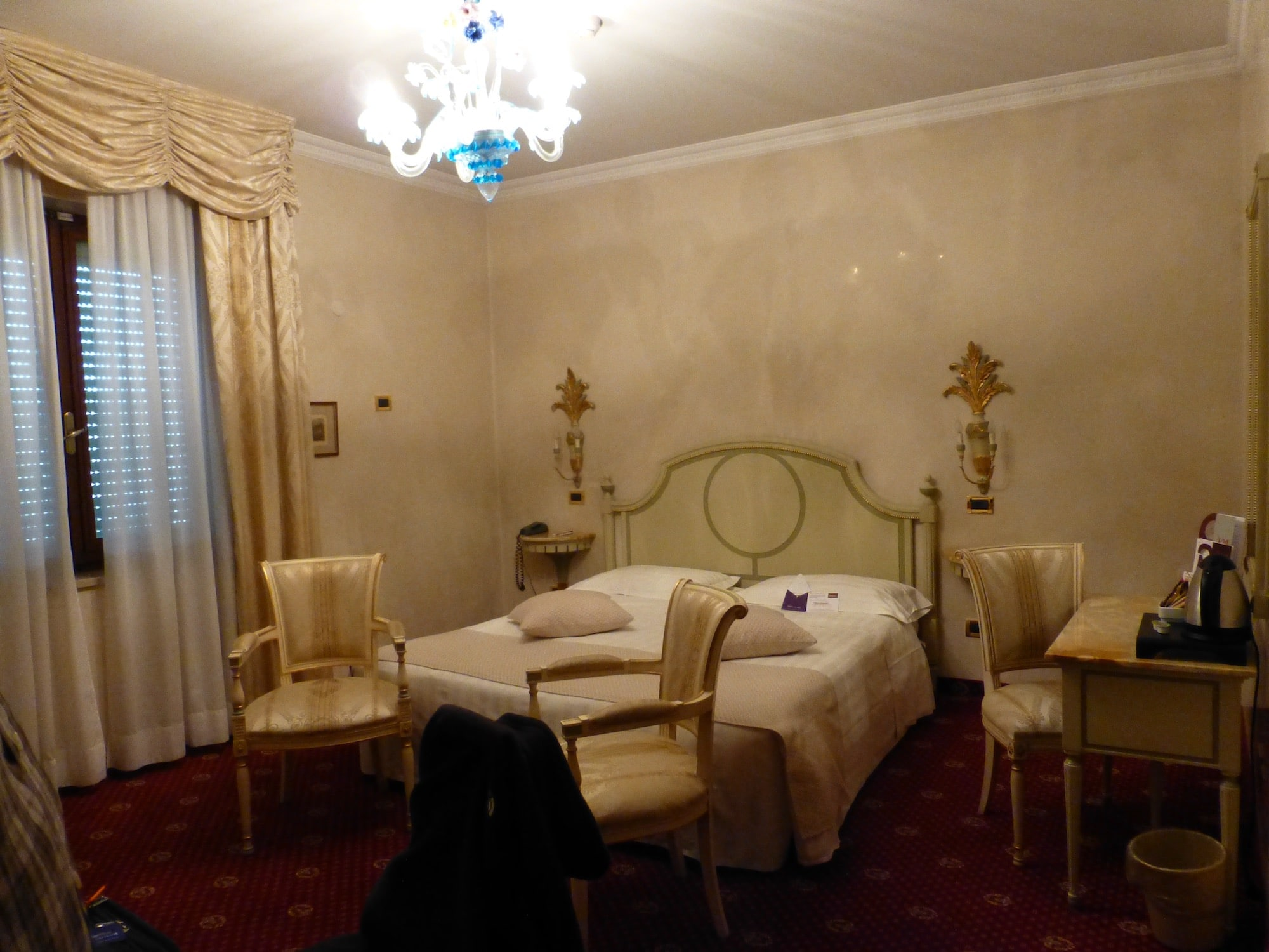 Cream and satin room at Parma Stendhal Hotel