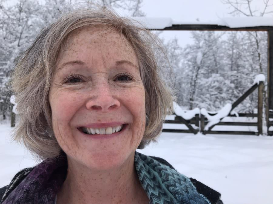 RoseMary Griffith hiking in snow