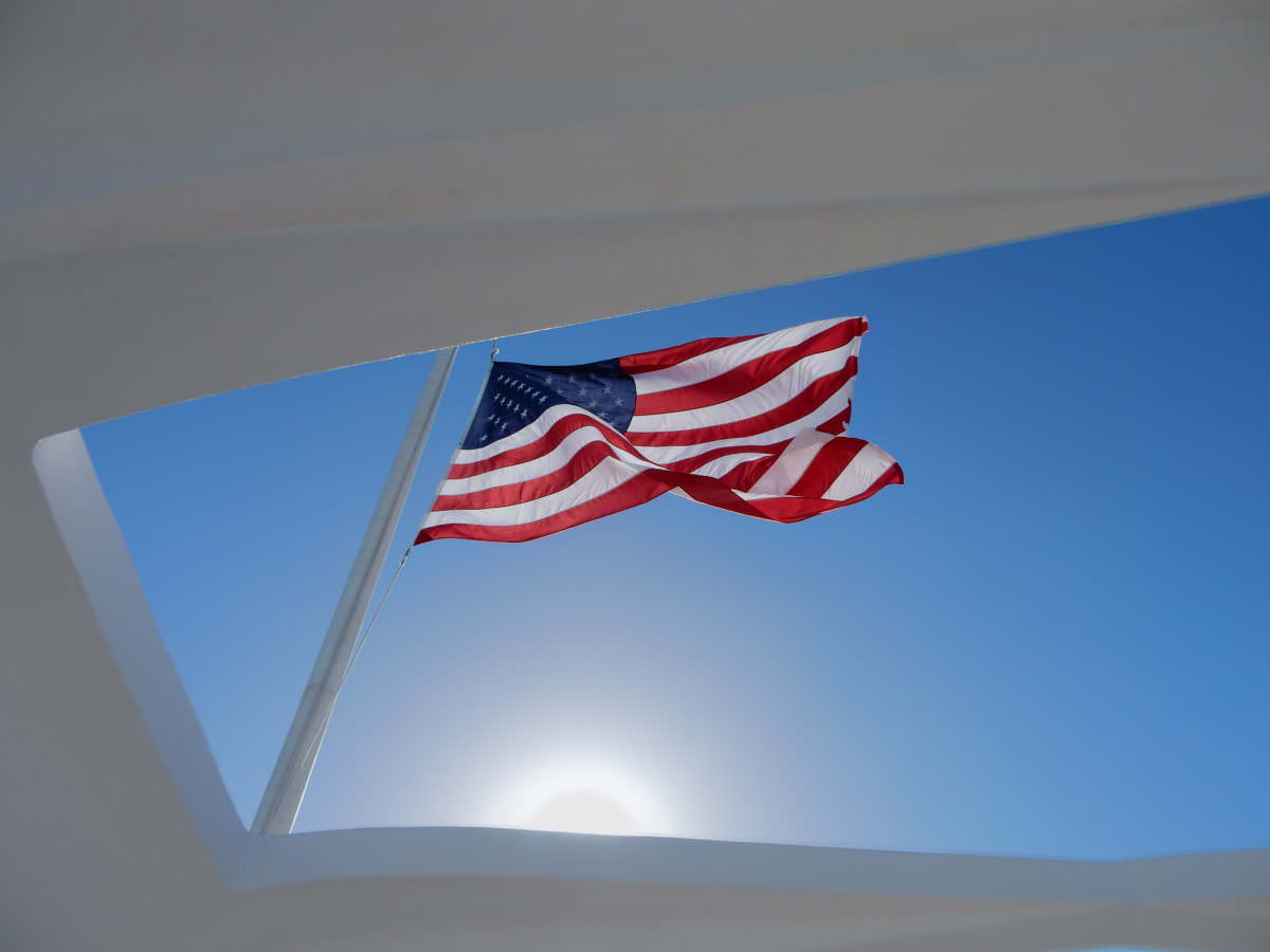 Flag flies from original mast of Arizona, Oahu, Pearl Harbor