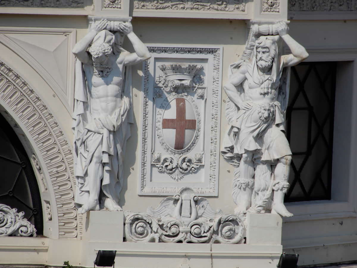Genoa train station support statues, cross coat of arms