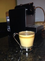 Coffee topped with cream, Nespresso machine
