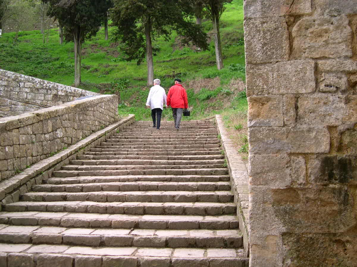 Couples stepping out - Volterra, Italy